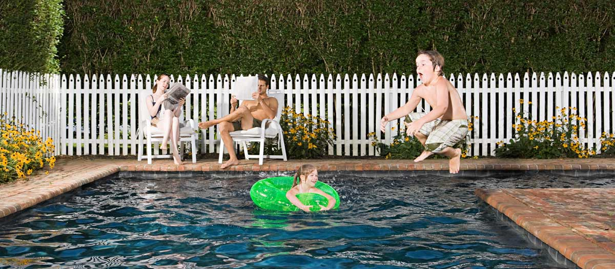 A family playing by the poolside