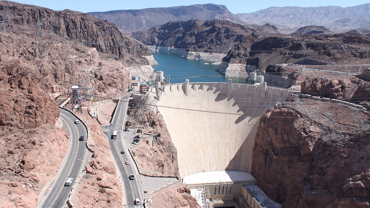 An aerial of Hoover Dam with Lake Mead in the background