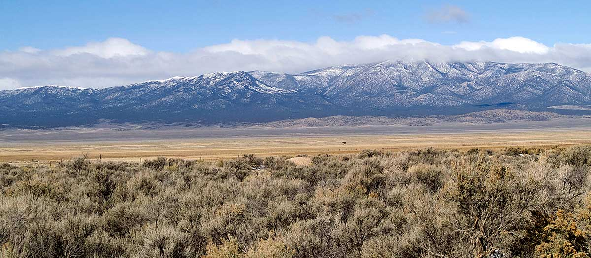 Snow-covered mountains are the backdrop for ranch land in Northern Nevada.