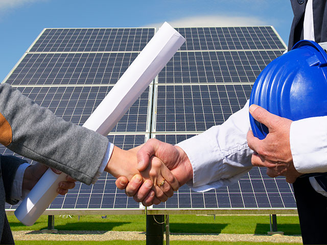 Handshake over solar panels