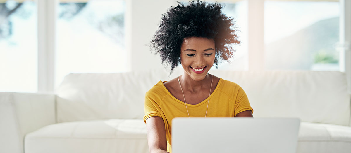 Smiling woman looking at laptop